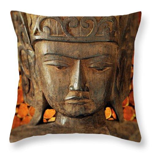 Asian Throw Pillow featuring the photograph Wooden Buddha by John Greim