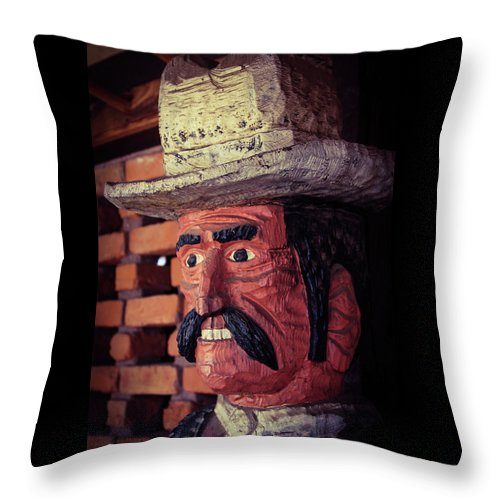 Cowboy Throw Pillow featuring the photograph Wooden Cowboy by Bonny Puckett