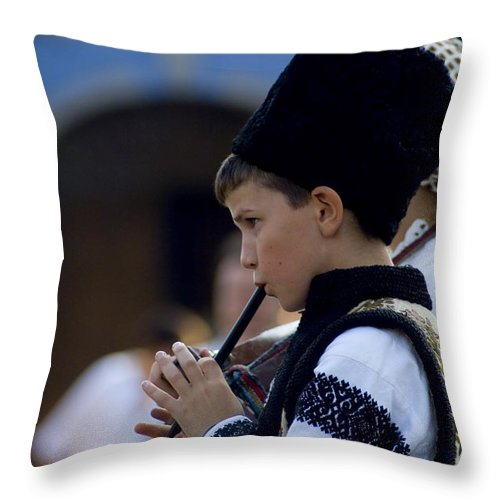 Wooden Flute Throw Pillow featuring the photograph Wooden Flute by Adrian Bud