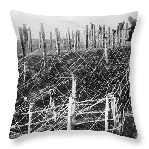 1914 Throw Pillow featuring the photograph World War I Barbed Wire by Granger