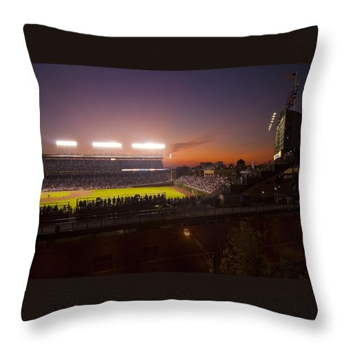 Cubs Throw Pillow featuring the photograph Wrigley Field At Dusk by Sven Brogren