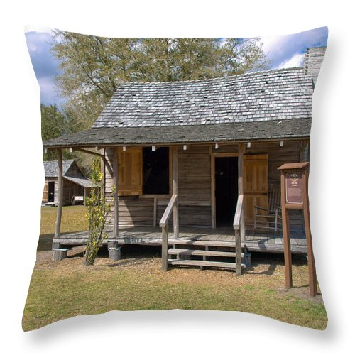 Cabin Throw Pillow featuring the photograph Yates Homestead Built In 1893 On Taylor Creek In Central Florida by Allan Hughes
