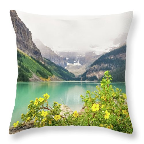 Alberta Throw Pillow featuring the photograph Yellow Flowers At Lake Louise by Daniela Constantinescu