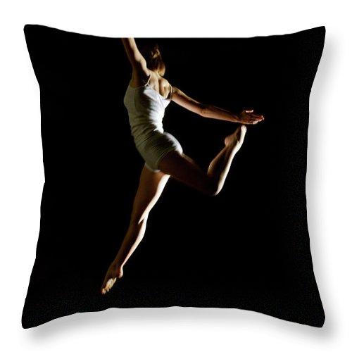 Ballet Dancer Throw Pillow featuring the photograph Ballet And Contemporary Dancers by John Rensten