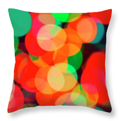 Holiday Throw Pillow featuring the photograph Defocused Lights by Tetra Images