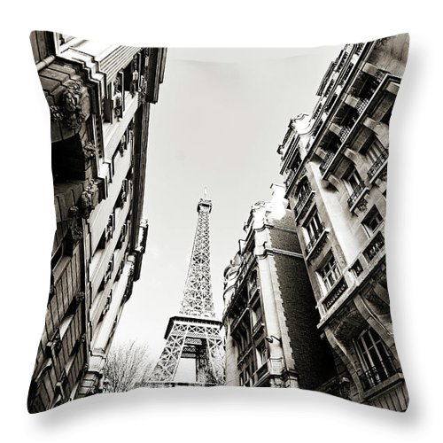 Built Structure Throw Pillow featuring the photograph Eiffel Tower Between Buildings In by Flory