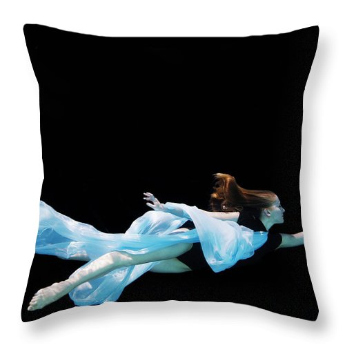 Ballet Dancer Throw Pillow featuring the photograph Female Dancer Underwater Against Black by Thomas Barwick