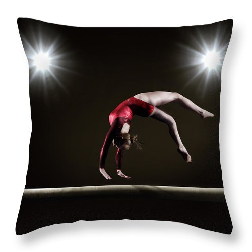 Expertise Throw Pillow featuring the photograph Female Gymnast On Balance Beam by Mike Harrington