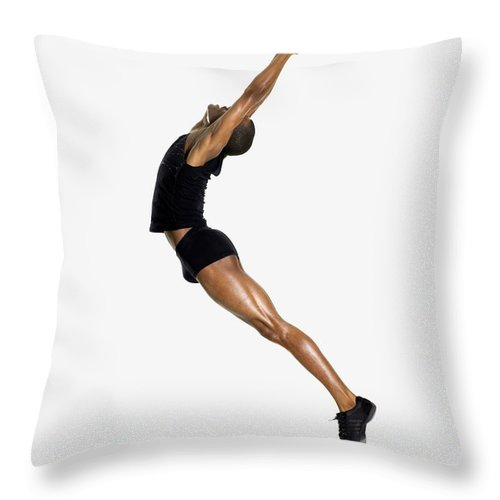 Young Men Throw Pillow featuring the photograph Male Dancer Jumping by Image Source