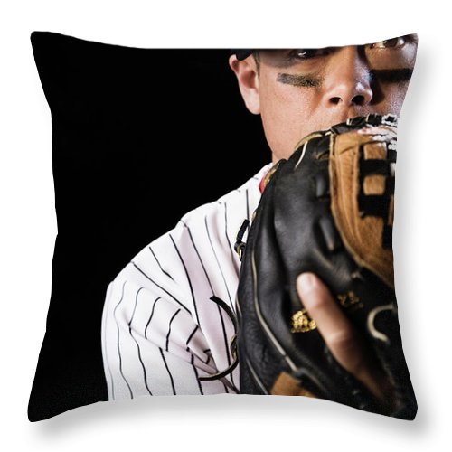 Baseball Cap Throw Pillow featuring the photograph Mixed Race Baseball Player Pitching by Hill Street Studios