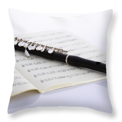 Sheet Music Throw Pillow featuring the photograph Piccolo On A Score by Imagenavi