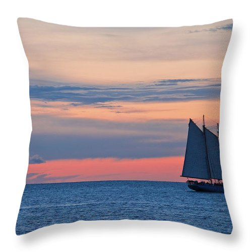 Sailboat Throw Pillow featuring the photograph Sailboat At Sunset by Thepalmer