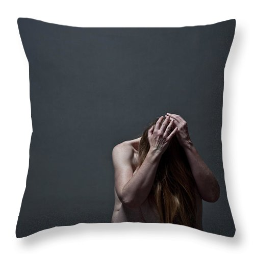 People Throw Pillow featuring the photograph Woman Crouched On Floor by Claudia Burlotti