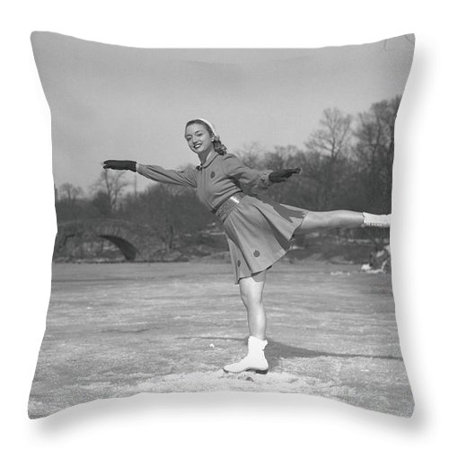 Human Arm Throw Pillow featuring the photograph Woman Ice Skating Outdoors, B&w by George Marks