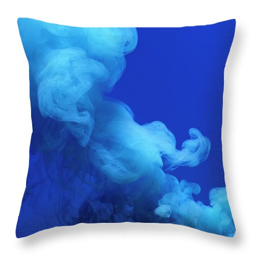 Motion Throw Pillow featuring the photograph Colored Smoke by Henrik Sorensen