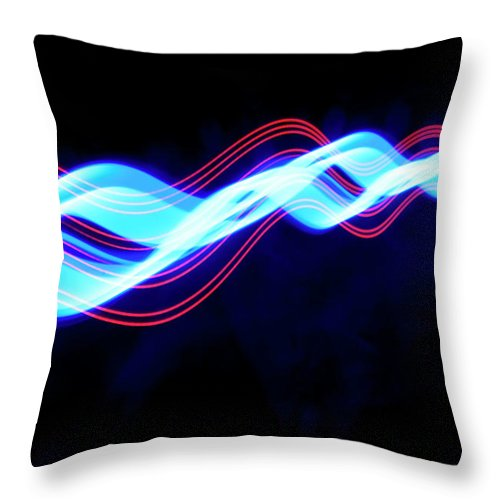 Black Background Throw Pillow featuring the photograph Abstract Light Trails And Streams by John Rensten
