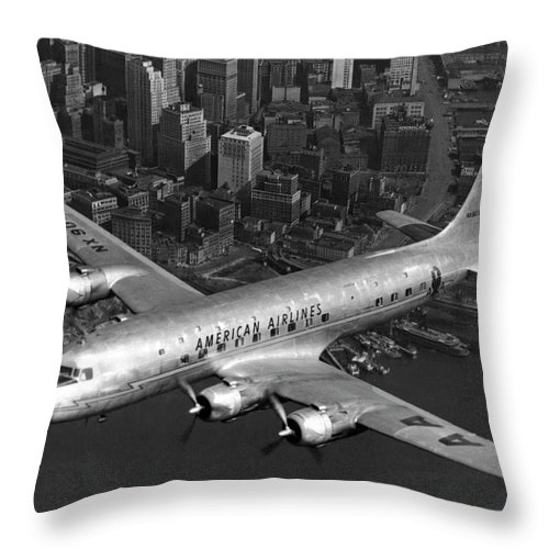 1947 Throw Pillow featuring the photograph American Dc-6 Flying Over Nyc by Underwood Archives