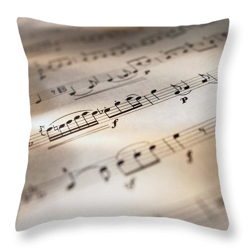 Sheet Music Throw Pillow featuring the photograph Detail Of Sheet Music by Ryan Mcvay