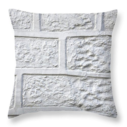 Abandoned Throw Pillow featuring the photograph White Brick Wall by Tom Gowanlock