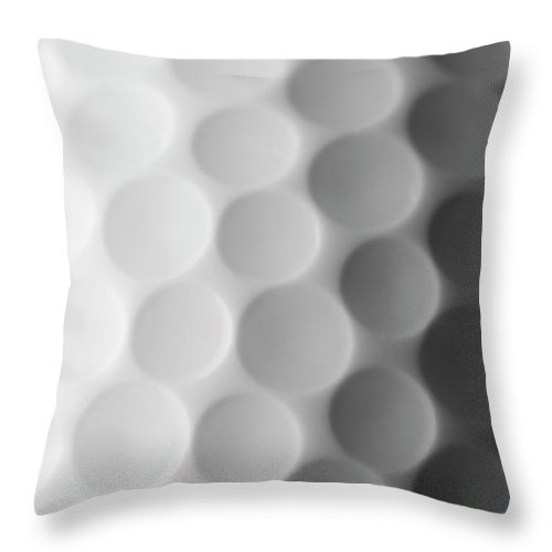 Ball Throw Pillow featuring the photograph A Close Up Shot Of A Golf Ball, White by Anthiacumming