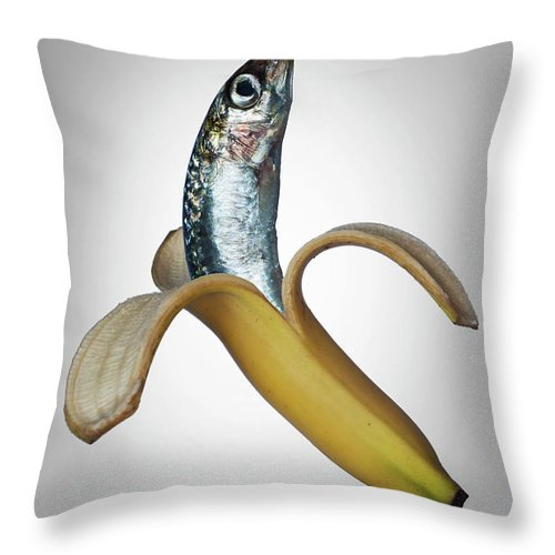 Confusion Throw Pillow featuring the photograph A Fish In A Banana by Buena Vista Images
