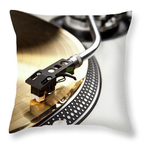 Music Throw Pillow featuring the photograph A Gold Record On A Turntable by Caspar Benson