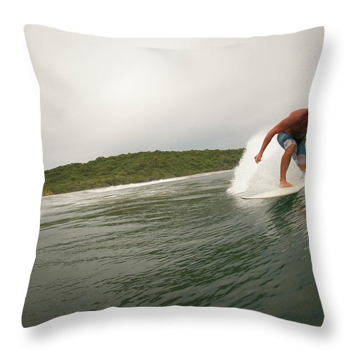 Focus Throw Pillow featuring the photograph A Male Surfer In A Barrel Of A Wave In by Sean Murphy