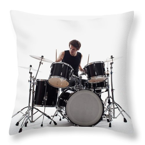 Cool Attitude Throw Pillow featuring the photograph A Man On Drums Performing, Studio Shot by Antenna