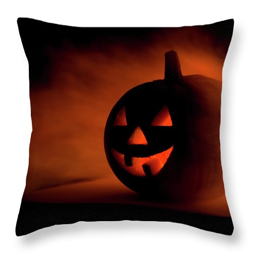 Horror Throw Pillow featuring the photograph A Scary Halloween Pumpkin In Smoke by Ilonabudzbon
