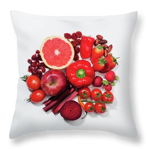 White Background Throw Pillow featuring the photograph A Selection Of Red Fruits & Vegetables by David Malan