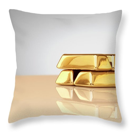 Four Objects Throw Pillow featuring the photograph A Stack Of Four Gold Ingots by Anthony Bradshaw