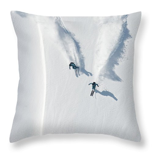 Crash Helmet Throw Pillow featuring the photograph Aerial View Of Two Skiers Skiing by Creativaimage