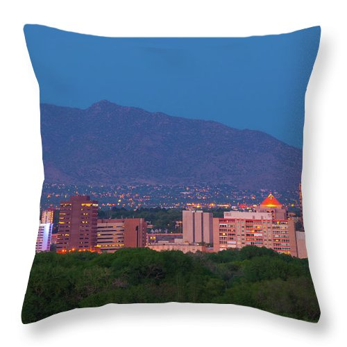 Downtown District Throw Pillow featuring the photograph Albuquerque Skyline At Dusk by Davel5957