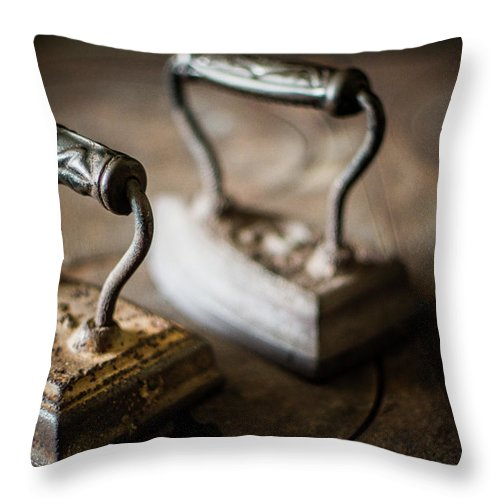 Two Objects Throw Pillow featuring the photograph Antique Irons by Jimss