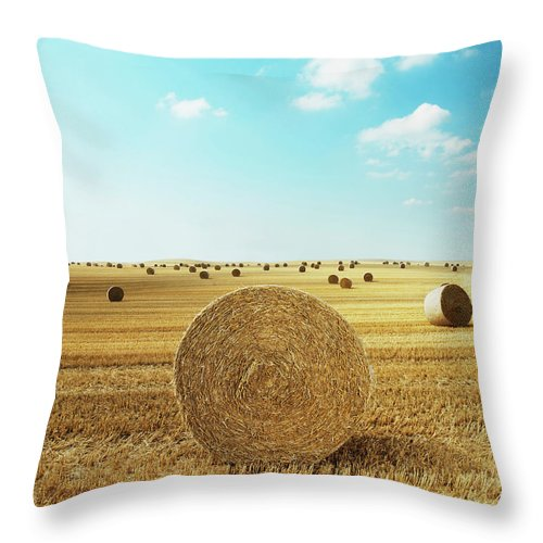 Field Stubble Throw Pillow featuring the photograph Bales Of Hay In Harvested Field by Henrik Sorensen