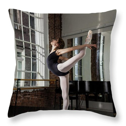 Ballet Dancer Throw Pillow featuring the photograph Ballerina Performing Attitude In Dance by Nisian Hughes