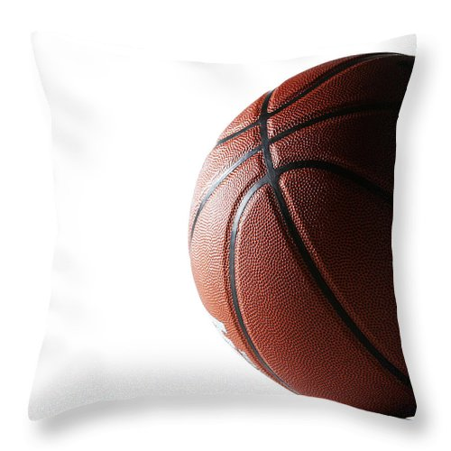 Recreational Pursuit Throw Pillow featuring the photograph Basketball On White Background by Thomas Northcut