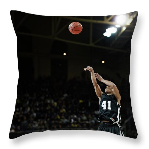 Expertise Throw Pillow featuring the photograph Basketball Player Shooting Jump Shot In by Thomas Barwick