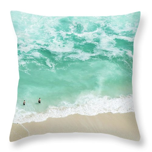 Scenics Throw Pillow featuring the photograph Bathers Swimming On Isolated Beach by Peter Chadwick