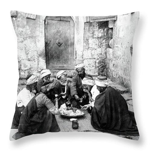 El Bireh Throw Pillow featuring the photograph El Bireh Feast by Munir Alawi