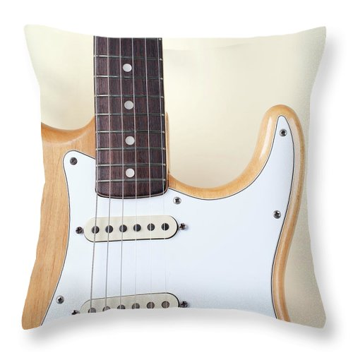 Rock Music Throw Pillow featuring the photograph Beige Wood Textured Electric Guitar by Neyya