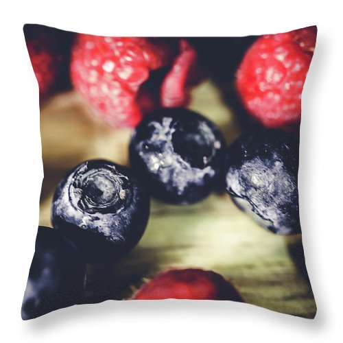 Berries Throw Pillow featuring the photograph Berries by Hyuntae Kim