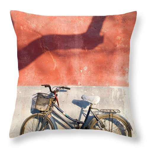Chinese Culture Throw Pillow featuring the photograph Bicycle Against Red Wall by Frankvandenbergh