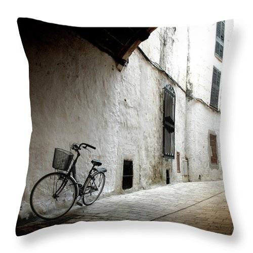 Tranquility Throw Pillow featuring the photograph Bicycle Leaning Wall by Antonio R. Ramos
