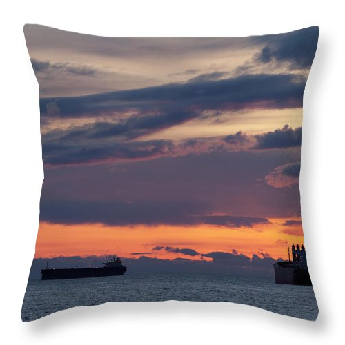 Scenics Throw Pillow featuring the photograph Big Boat Silhouettes by Visualcommunications