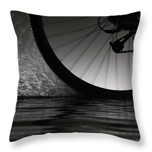 Recreational Pursuit Throw Pillow featuring the photograph Bike Riding Through Water by Jonathan Knowles