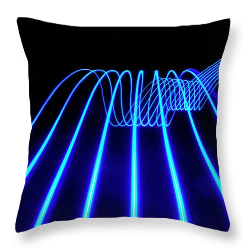 Laser Throw Pillow featuring the photograph Blue Abstract Coloured Lights Trails by John Rensten