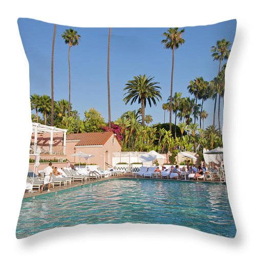 Tranquility Throw Pillow featuring the photograph Blue-bottomed Pool Beneath Palm Trees by Barry Winiker
