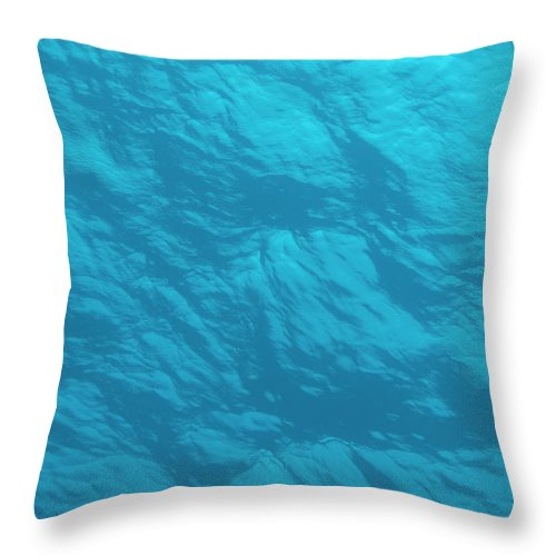 Tranquility Throw Pillow featuring the photograph Blue Ocean Water Surface As Seen From by Jeff Hunter