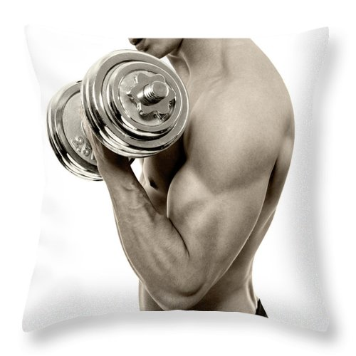 Young Men Throw Pillow featuring the photograph Body Builder Exercising by Gilaxia